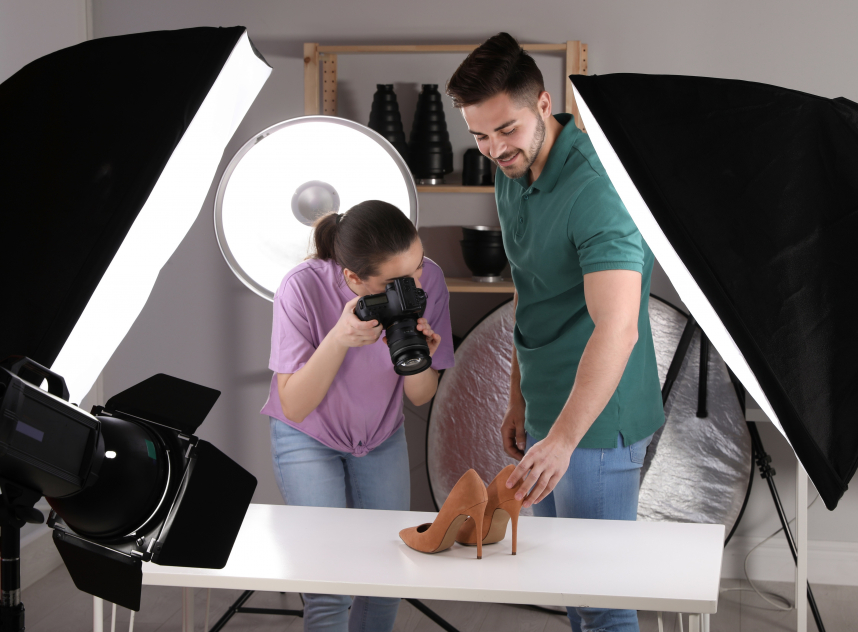 Professional photographers shooting stylish shoes in studio